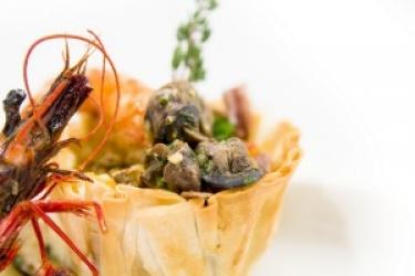 Zdjęcie główne #146 -  Makaron ze ślimakami w sosie z karmelizowanych cytryn i miodu